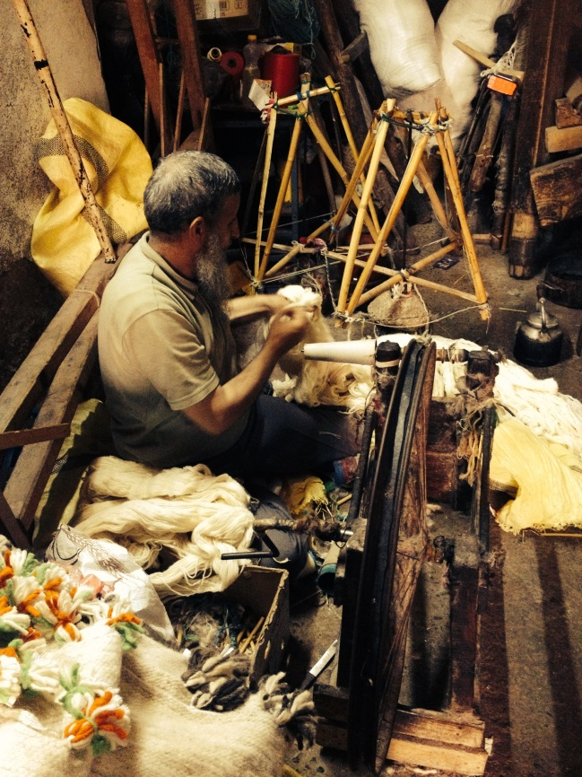 Spinning yarn in Essaouira, Maroc
