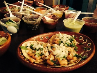 Oh man, words cannot describe the bliss of these tacos, and all of those fiery sauces.