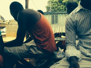 Hanging out with the guys at the butcher's shop in Nsuta, playing yahtzee, drafts, and rummy.