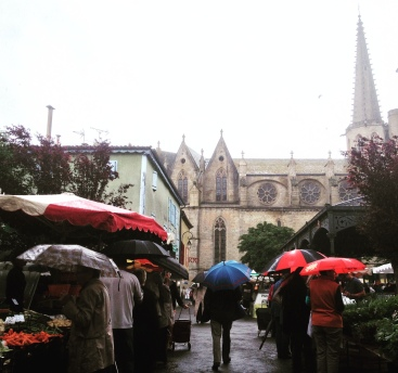 The weekly market in Mirepoix on a rainy Monday morning